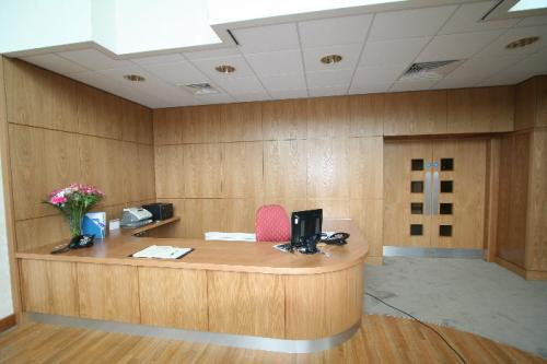 wooden reception desk with curved edge
