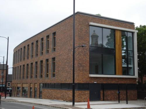 brick building with wooden cladding