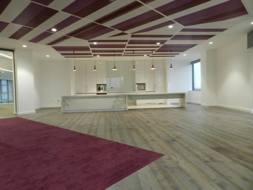 purple ceiling cladding over white marble kitchen area