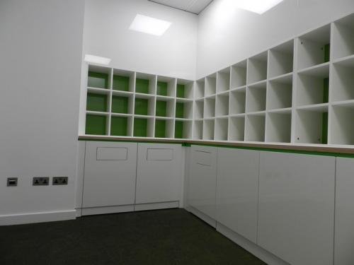 green background white storage shelves