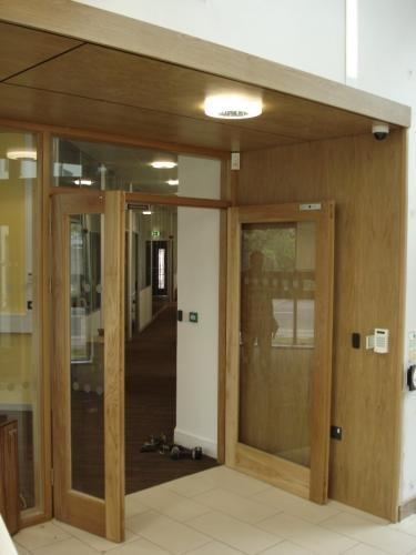 glass double doors with wooden frame