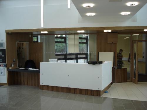 white and wood grain reception desk