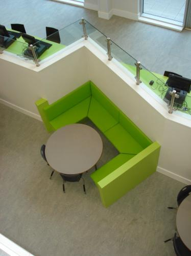 green seating area with round table