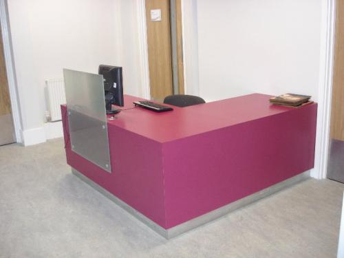 pink reception desk