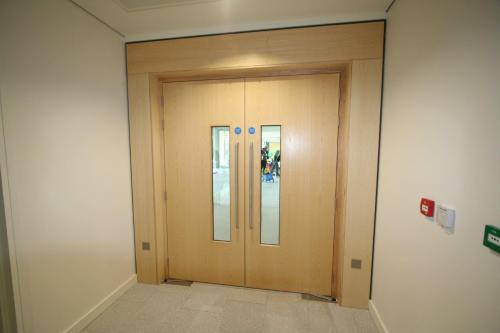 wooden double doors with wooden surround