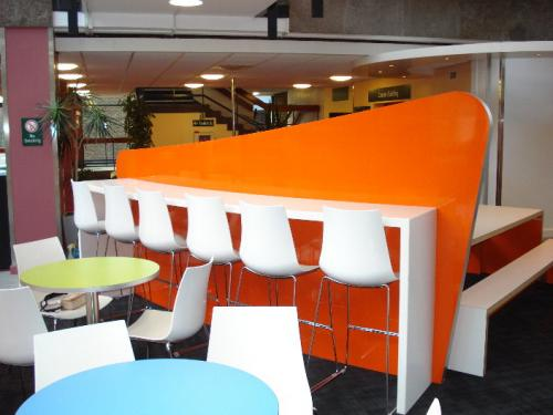 tall bar with seats and orange backing