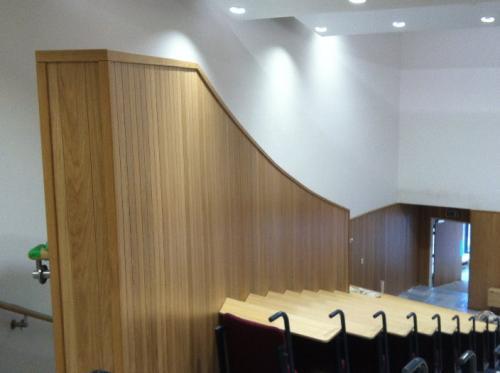 wooden cladding along wall