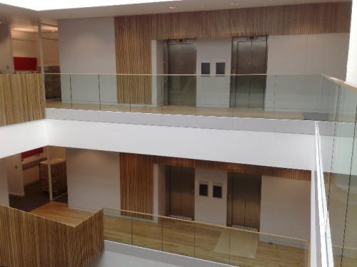 wooden cladding surrounding lifts