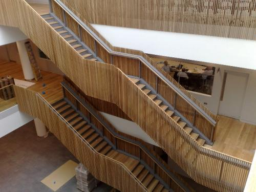 wooden staircase with cladding