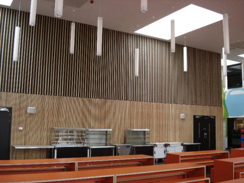 wooden cladding high ceiling with dangling lights